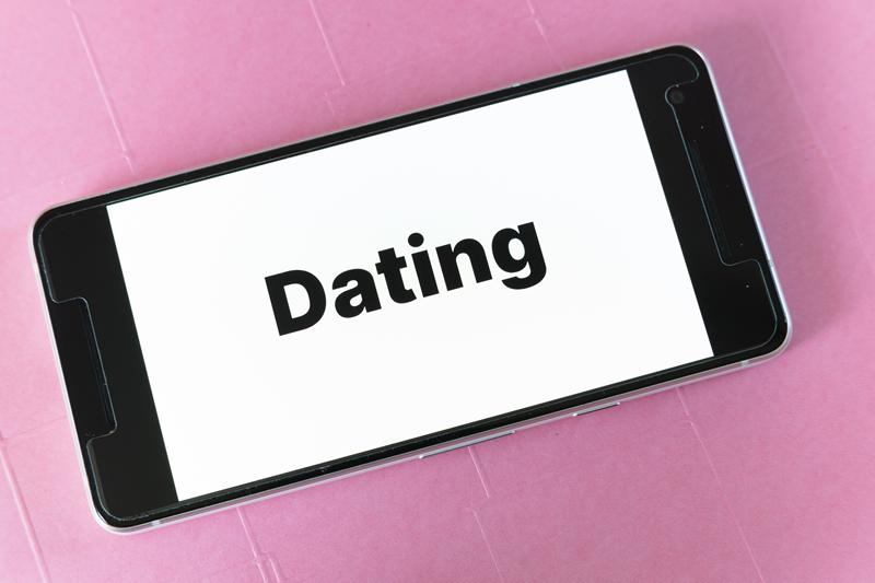 A phone with the word dating on it