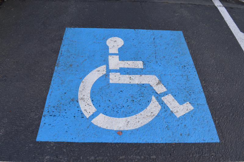 mobility parking spot with the blue wheelchair symbol